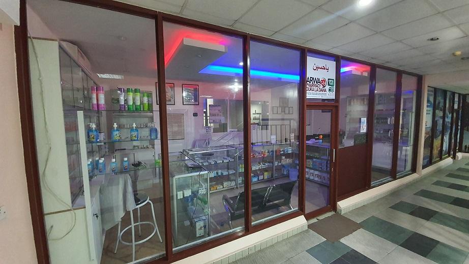 Pharmacy main entrance covering whole length
